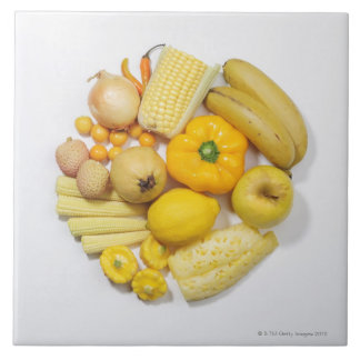 A selection of yellow fruits & vegetables. tile