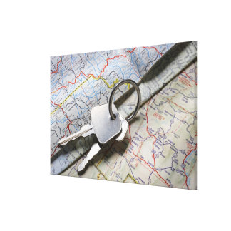 A set of car keys on a pile of road maps. canvas print