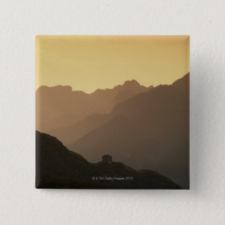 A setting sun filters through a sandstorm from 15 cm square badge