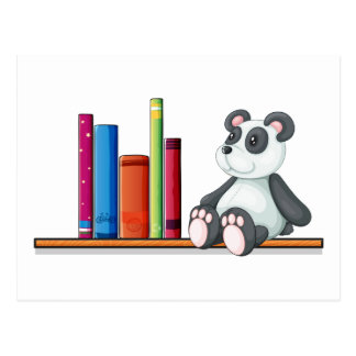 A shelf with books and a toy panda postcard