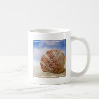 A Shell Propped In The Sand Coffee Mug