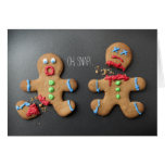 A shocked gingerbread man with broken leg greeting card
