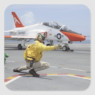 A shooter aboard the aircraft carrier square sticker