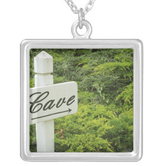 A sign pointing tho the wine cellar (Cave) in Silver Plated Necklace