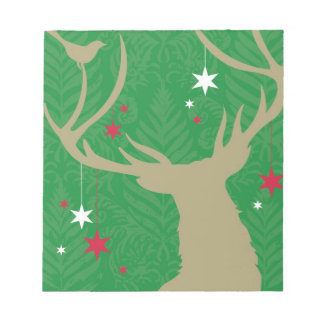 A silhouette of a deer with stars hanging from its notepad