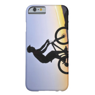 A silhouette of a mountain biker at sunset on barely there iPhone 6 case