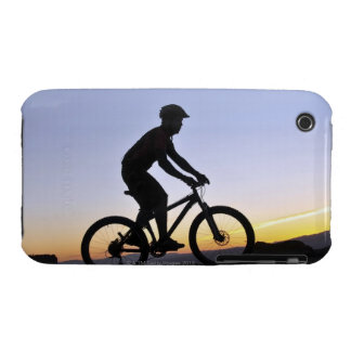 A silhouette of a mountain biker at sunset on Case-Mate iPhone 3 case