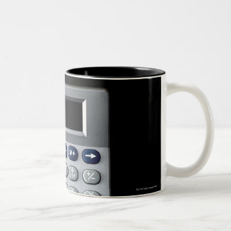 A silver calculator Two-Tone mug
