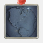A simple blue global map of the earth showing christmas ornaments