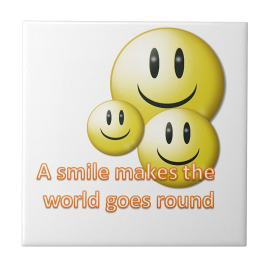 A smile makes the  world goes round small square tile