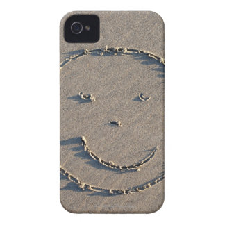 A smiley face drawn in sand. iPhone 4 cover