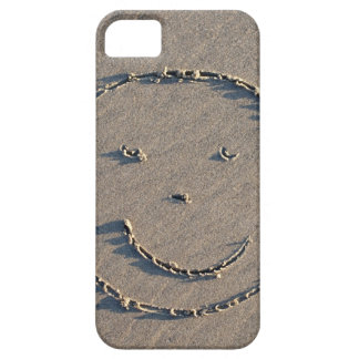 A smiley face drawn in sand. iPhone 5 covers