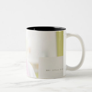 A smiling childminder Two-Tone coffee mug