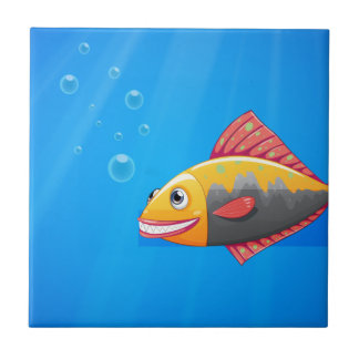 A smiling fish in the ocean small square tile