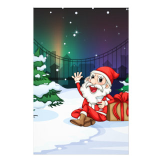 A smiling Santa beside the gift Custom Stationery