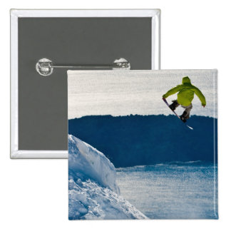 A snowboarder jumping 15 cm square badge