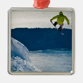 A snowboarder jumping Silver-Colored square decoration