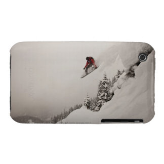 A snowboarder jumps off a cliff into powder in iPhone 3 case