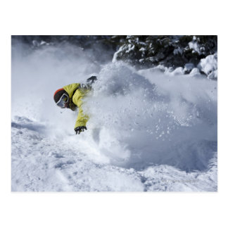 A snowboarder rips untracked powder turns in 2 postcard
