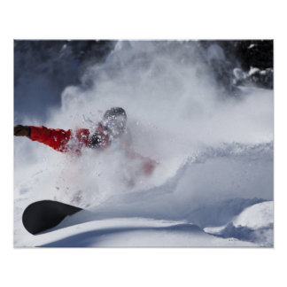 A snowboarder rips untracked powder turns in poster