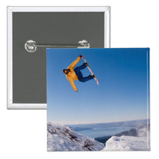 A snowboarder spins off a jump in Argentina 15 Cm Square Badge