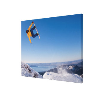 A snowboarder spins off a jump in Argentina Canvas Print
