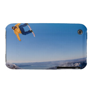A snowboarder spins off a jump in Argentina iPhone 3 Case-Mate Cases