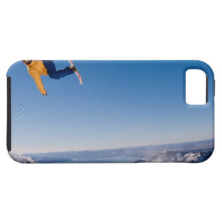 A snowboarder spins off a jump in Argentina iPhone 5 Covers