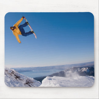 A snowboarder spins off a jump in Argentina Mouse Mat