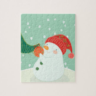 A snowman hanging an ornament on a tree jigsaw puzzle