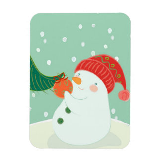 A snowman hanging an ornament on a tree vinyl magnet