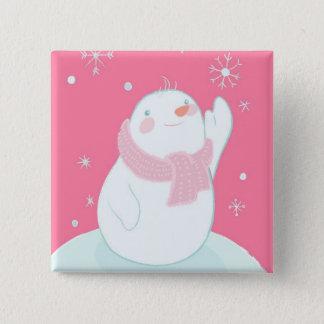 A snowman reaching for a falling snowflake 15 cm square badge