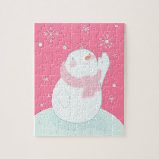 A snowman reaching for a falling snowflake jigsaw puzzle