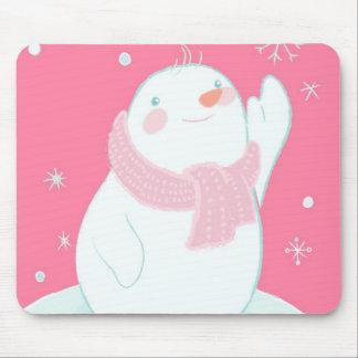 A snowman reaching for a falling snowflake mouse mat