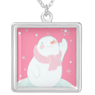 A snowman reaching for a falling snowflake silver plated necklace