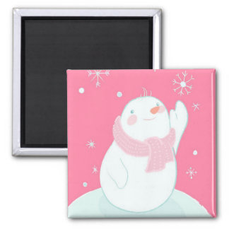A snowman reaching for a falling snowflake square magnet