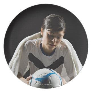 A soccer player 7 dinner plates