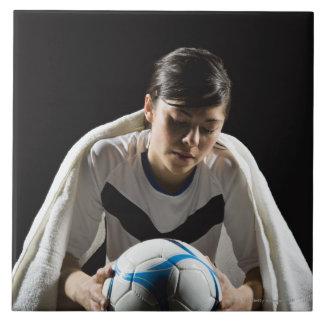 A soccer player 7 tile