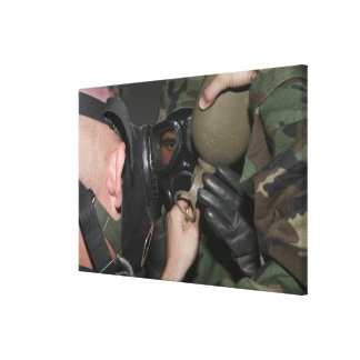 A solder assists a Marine Canvas Print