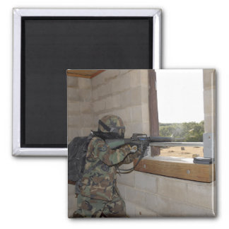 A soldier acts as an opposition force refrigerator magnet