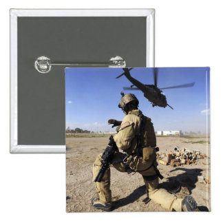 A soldier conducts security for an HH-60 15 Cm Square Badge