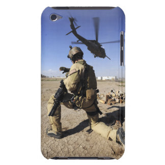 A soldier conducts security for an HH-60 Case-Mate iPod Touch Case