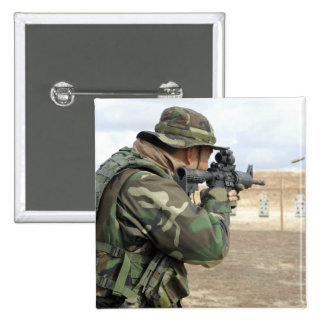 A soldier fires rounds down range 15 cm square badge