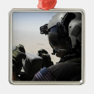 A soldier provides security christmas ornament