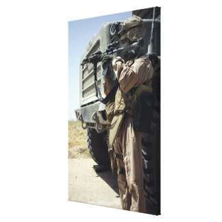 A soldier provides security for Marines Canvas Print