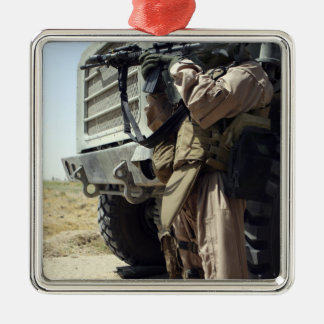 A soldier provides security for Marines Christmas Ornament