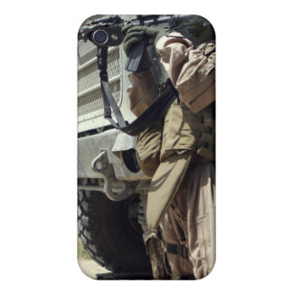 A soldier provides security for Marines iPhone 4/4S Cases