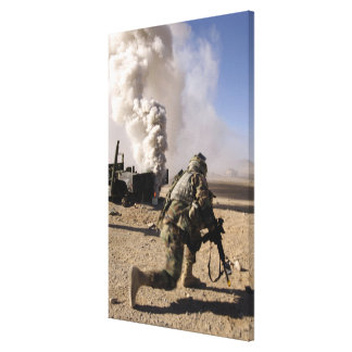 A Soldier reacts to a controlled explos Canvas Print