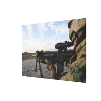 A soldier sights in to fire on a target canvas print