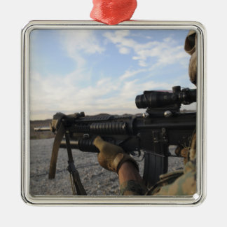 A soldier sights in to fire on a target christmas ornament